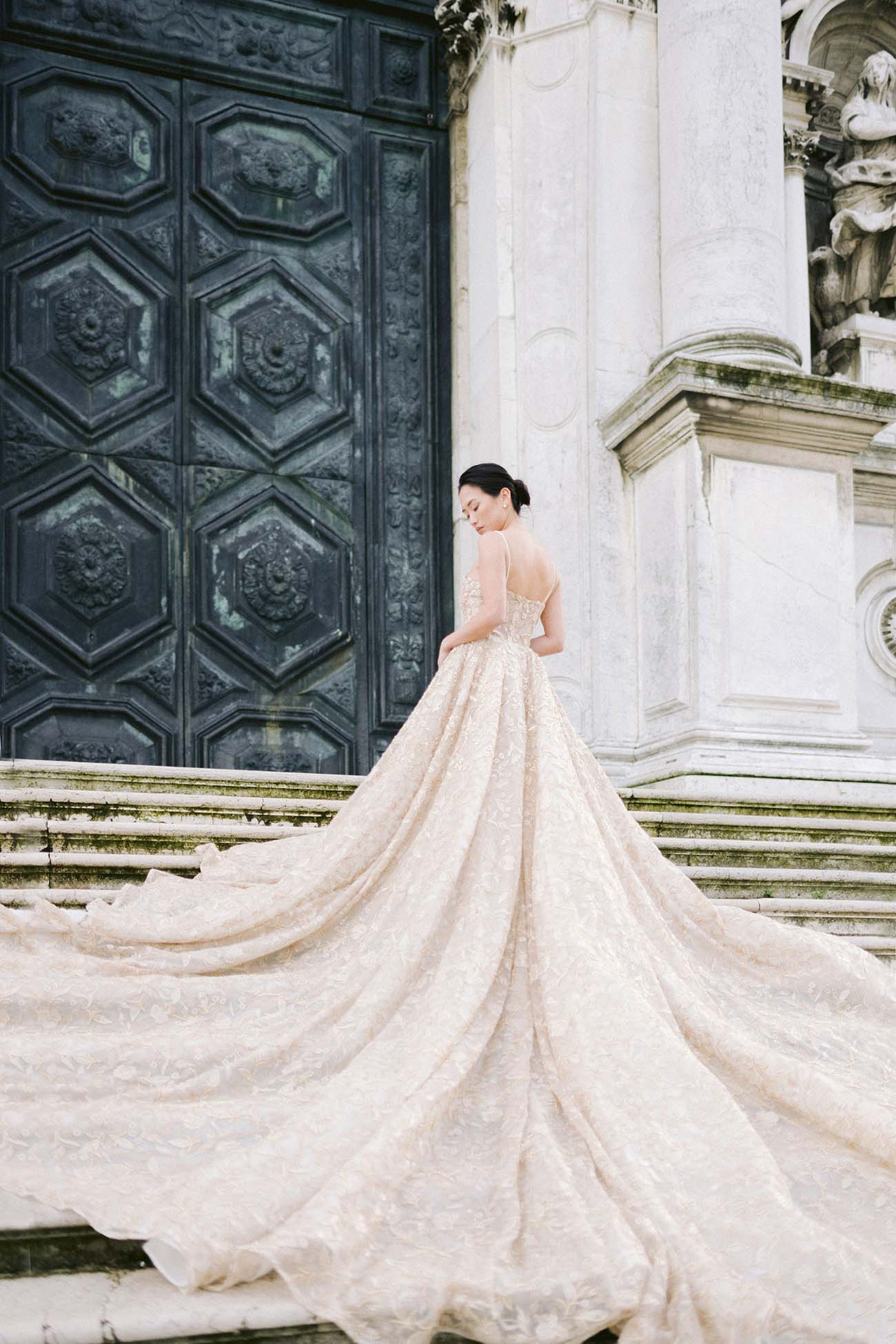 a bride poses on the basilica maria di santa step
