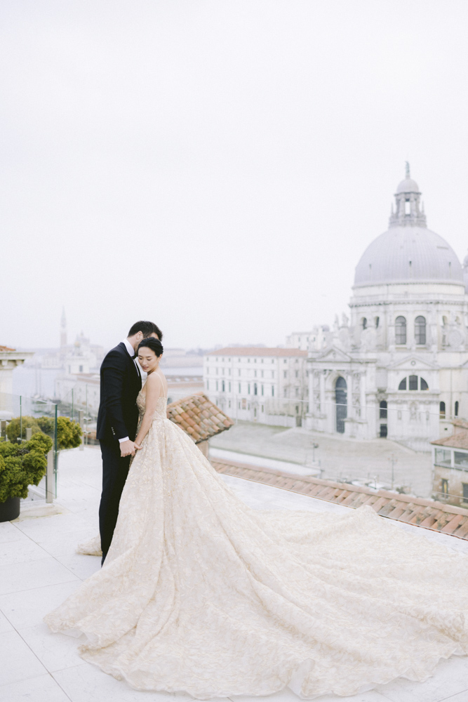 a couple on the roofs of the gritti palace in venice